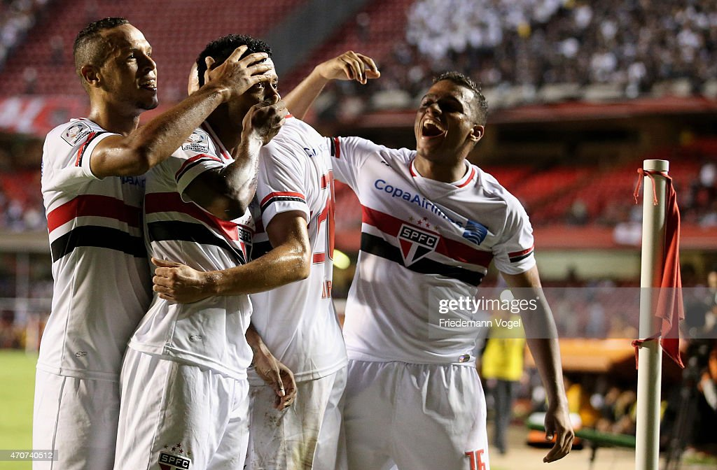 <a gi-track='captionPersonalityLinkClicked' href=/galleries/search?phrase=Michel+Bastos&family=editorial&specificpeople=1549621 ng-click='$event.stopPropagation()'>Michel Bastos</a> (C) of Sao Paulo celebrates scoring the second goal with his team during a match between Sao Paulo and Corinthians as part of Group 2 of Copa Bridgestone Libertadores at Morumbi Stadium on April 22, 2015 in Sao Paulo, Brazil.