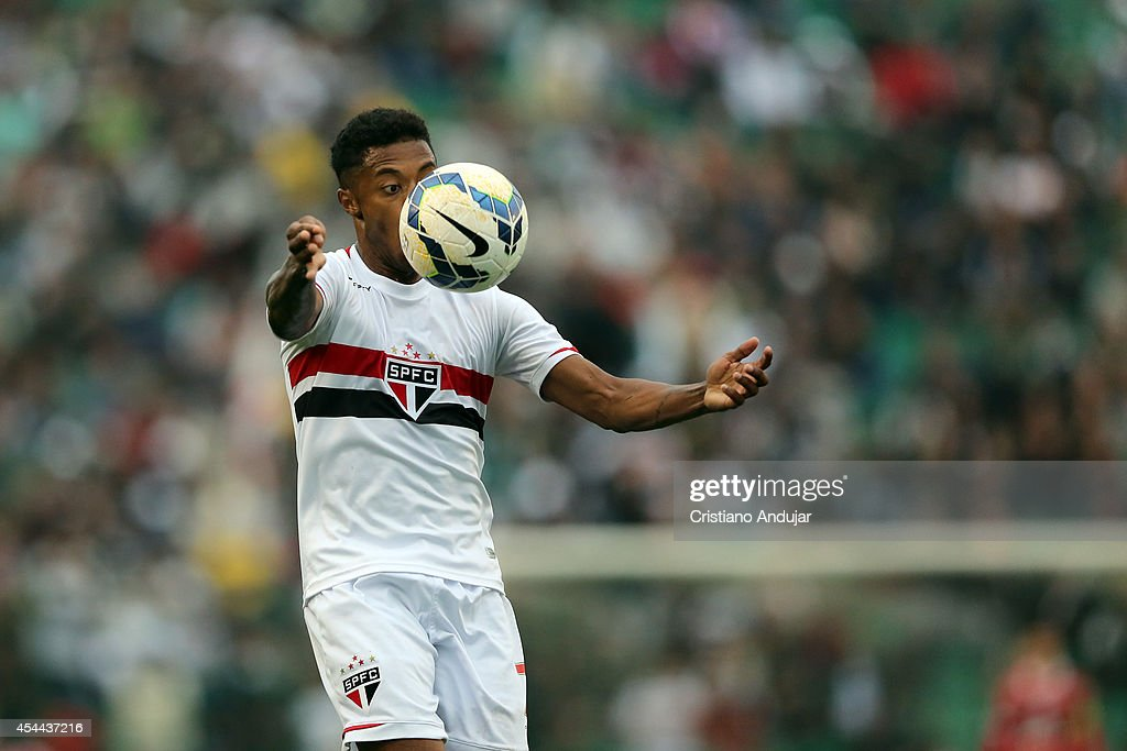 <a gi-track='captionPersonalityLinkClicked' href=/galleries/search?phrase=Michel+Bastos&family=editorial&specificpeople=1549621 ng-click='$event.stopPropagation()'>Michel Bastos</a> #7 of Sao Paulo in action during a match between Figueirense and Sao Paulo as part of Campeonato Brasileiro 2014 at Orlando Scarpelli Stadium on August 31, 2014 in Florianopolis, Brazil