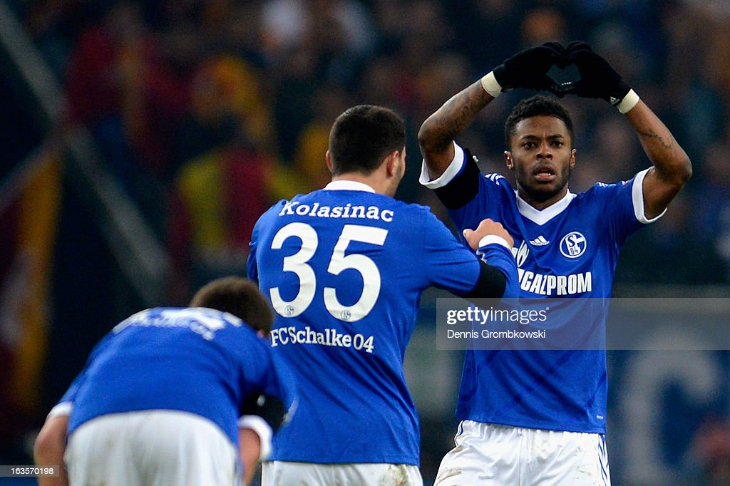 <a gi-track='captionPersonalityLinkClicked' href=/galleries/search?phrase=Michel+Bastos&family=editorial&specificpeople=1549621 ng-click='$event.stopPropagation()'>Michel Bastos</a> of Schalke celebrates after scoring his team's second goal during the UEFA Champions League round of 16 second leg match between Schalke 04 and Galatasaray AS at Veltins-Arena on March 12, 2013 in Gelsenkirchen, Germany.