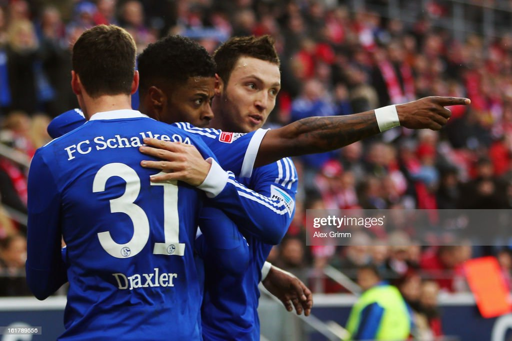 <a gi-track='captionPersonalityLinkClicked' href=/galleries/search?phrase=Michel+Bastos&family=editorial&specificpeople=1549621 ng-click='$event.stopPropagation()'>Michel Bastos</a> (C) of Schalke celebrates his team's first goal with team mates <a gi-track='captionPersonalityLinkClicked' href=/galleries/search?phrase=Julian+Draxler&family=editorial&specificpeople=7184479 ng-click='$event.stopPropagation()'>Julian Draxler</a> (front) and <a gi-track='captionPersonalityLinkClicked' href=/galleries/search?phrase=Marco+Hoeger&family=editorial&specificpeople=6872414 ng-click='$event.stopPropagation()'>Marco Hoeger</a> during the Bundesliga match between 1. FSV Mainz 05 and FC Schalke 04 at Coface Arena on February 16, 2013 in Mainz, Germany.