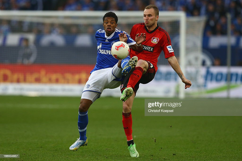 <a gi-track='captionPersonalityLinkClicked' href=/galleries/search?phrase=Michel+Bastos&family=editorial&specificpeople=1549621 ng-click='$event.stopPropagation()'>Michel Bastos</a> of Schalke challenges <a gi-track='captionPersonalityLinkClicked' href=/galleries/search?phrase=Michal+Kadlec&family=editorial&specificpeople=2156641 ng-click='$event.stopPropagation()'>Michal Kadlec</a> of Leverkusen during the Bundesliga match between FC Schalke 04 and Bayer 04 Leverkussen at Veltins-Arena on April 13, 2013 in Gelsenkirchen, Germany.