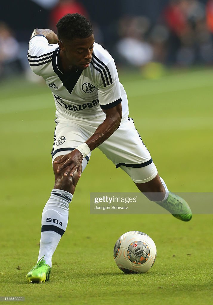 Michel Bastos of Schalke controls the ball dring Raul's farewell match between Schalke 04 and Al-Sadd Sports Club Katar at Veltins Arena on July 27, 2013 in Gelsenkirchen, Germany.