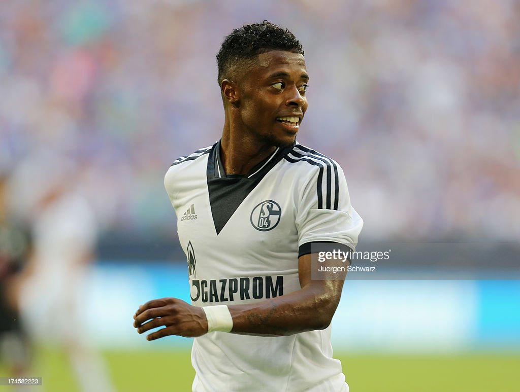 <a gi-track='captionPersonalityLinkClicked' href=/galleries/search?phrase=Michel+Bastos&family=editorial&specificpeople=1549621 ng-click='$event.stopPropagation()'>Michel Bastos</a> of Schalke smiles during Raul's farewell match between Schalke 04 and Al-Sadd Sports Club Katar at Veltins Arena on July 27, 2013 in Gelsenkirchen, Germany.