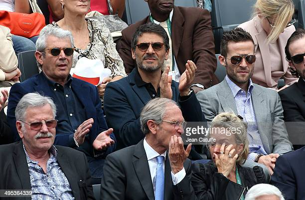 Michel Boujenah Pascal Elbe and Yohan Cabaye watch Gael Monfils' match on Day 9 of the French Open 2014 held at RolandGarros stadium on June 2 2014...