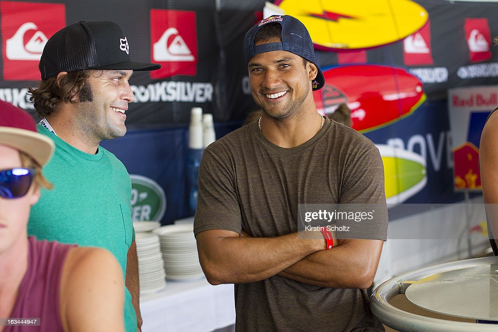 Michel Bourez of Tahiti (R) laughs with a friend during the Quiksilver Pro on March 10, 2013 in Gold Coast, Australia.