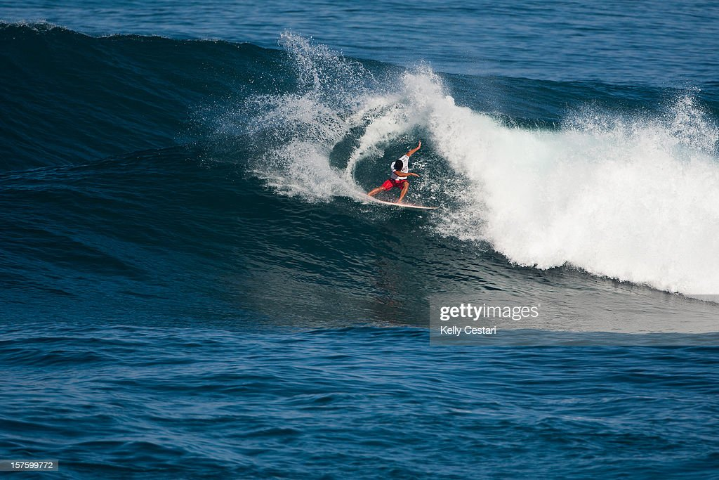 <a gi-track='captionPersonalityLinkClicked' href=/galleries/search?phrase=Michel+Bourez&family=editorial&specificpeople=2106516 ng-click='$event.stopPropagation()'>Michel Bourez</a> of Tahiti surfs in the Vans World Cup of Surfing at Sunset Beach on December 4, 2012 in North Shore, Hawaii. Bourez placed equal 13th.