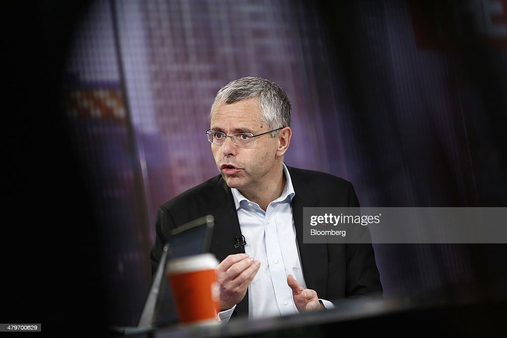 <a gi-track='captionPersonalityLinkClicked' href=/galleries/search?phrase=Michel+Combes&family=editorial&specificpeople=6531244 ng-click='$event.stopPropagation()'>Michel Combes</a>, chief executive officer of Alcatel-Lucent SA, gestures during a Bloomberg Television interview in London, U.K., on Thursday, March 20, 2014. Alcatel-Lucent, the network-equipment maker that returned to a profit for the first time in two years last quarter, predicted it can win market share from rivals without slashing prices. Photographer: Simon Dawson/Bloomberg via Getty Images