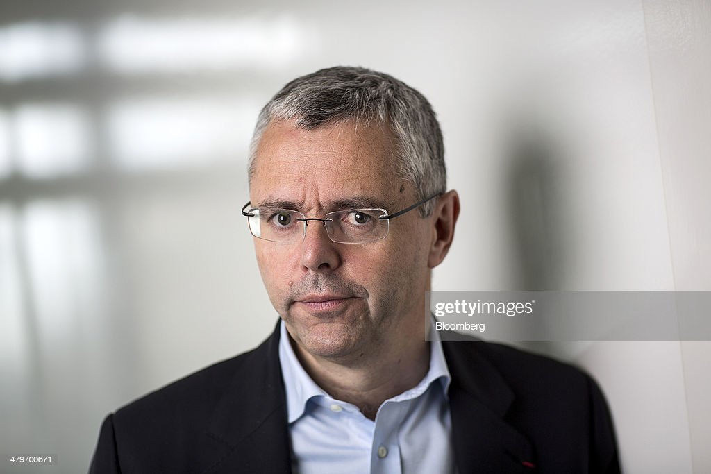<a gi-track='captionPersonalityLinkClicked' href=/galleries/search?phrase=Michel+Combes&family=editorial&specificpeople=6531244 ng-click='$event.stopPropagation()'>Michel Combes</a>, chief executive officer of Alcatel-Lucent SA, poses for a photograph following a Bloomberg Television interview in London, U.K., on Thursday, March 20, 2014. Alcatel-Lucent, the network-equipment maker that returned to a profit for the first time in two years last quarter, predicted it can win market share from rivals without slashing prices. Photographer: Simon Dawson/Bloomberg via Getty Images