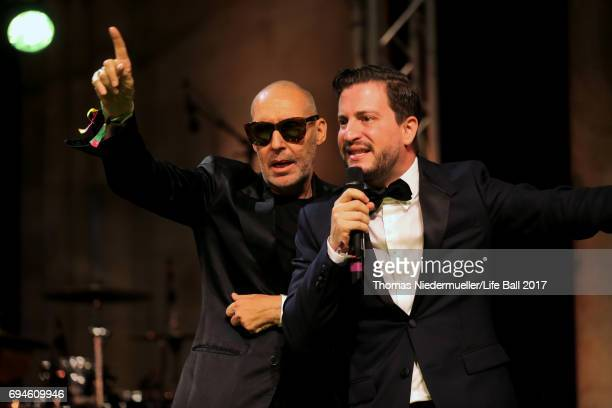 Michel Comte and Rafael Schwarz speak at the Life Ball 2017 Gala Dinner at City Hall on June 10 2017 in Vienna Austria