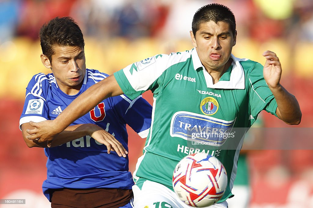 Michel Contreras of Universidad de Chile fights for the ball with Alexis Delgado of Audax Italiano during a match between Universidad de Chile and Audax Italiano as part of the Torneo Transición 2013 at Santa Laura Stadium on February 01, 2013 in Santiago, Chile.