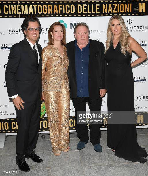 Michel Curatolo Carole Bouquet Gerard Depardieu and Tiziana Rocca attend Nations Award gala dinner on July 28 2017 in Taormina Italy