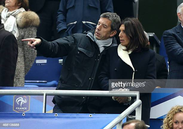 Michel Cymes and his wife Nathalie Cymes attend the international friendly match between France and Brazil at Stade de France on March 26 2015 in...