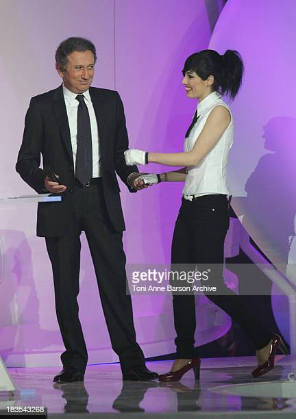 Michel Drucker and Jennifer Ayache of Superbus during 2007 Victoires de la Musique Show at Zenith de Paris in Paris France