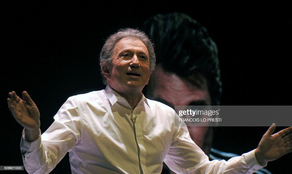 Michel Drucker is seen at the Zenith d'Amiens during his One Man show on February 12, 2016. / AFP / FRANCOIS LO PRESTI