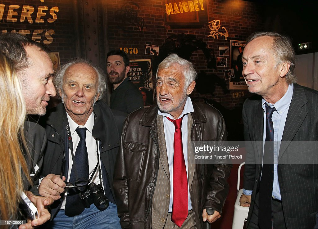Michel Faury, head of BRI (Brigade for Research and Intervention), journalist Christian Brincourt, legendary actor Jean-Paul Belmondo and lawyer Michel Godest share a light moment as they attend the '100th Anniversary Of The Paris Judiciary Police' exhibition opening on November 8, 2013 in Paris, France.