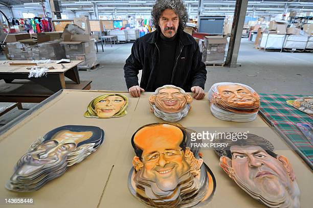 Michel Foucault drawner and sculptor at the Cesar mask maker company poses in front of 2012 French presidential election candidates masks he created...