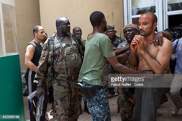 Michel Gbagbo the son of the president Laurent Gbagbo is seen upon to his arrival at the Hotel du Golf He has been beaten by the supporters of...