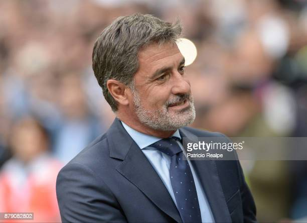 Michel Gonzalez coach of Malaga smiles during a match between Real Madrid and Malaga as part of La Liga at Santiago Bernabeu Stadium on November 25...