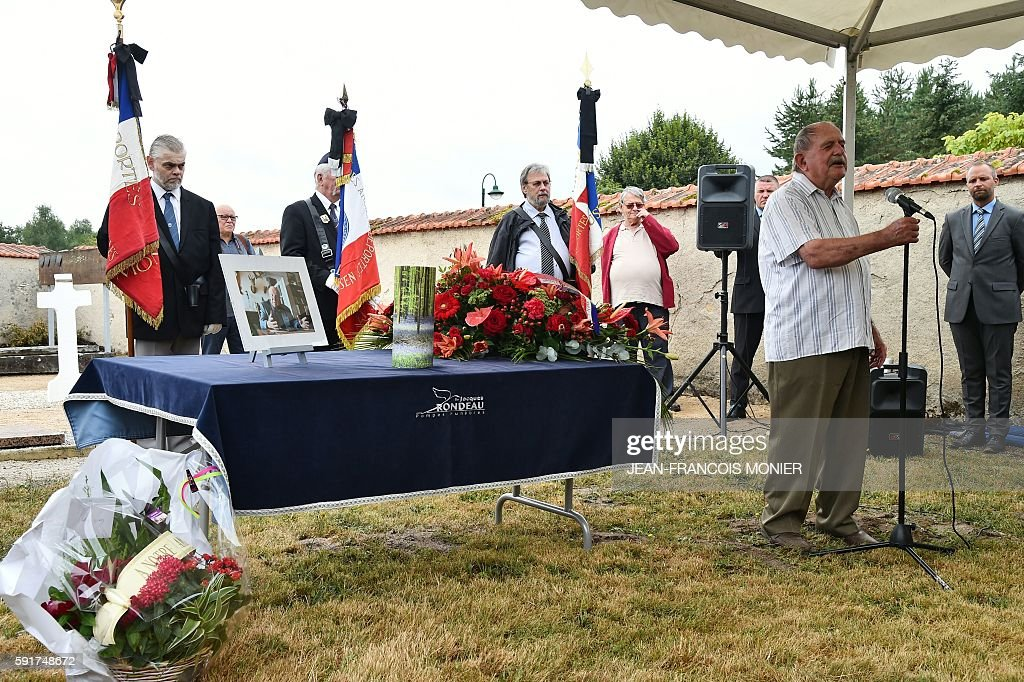 Michel Guerin former mayor of Saran speaks as he stands next to the urn during the funeral of Georges Seguy former secretary general of French major...
