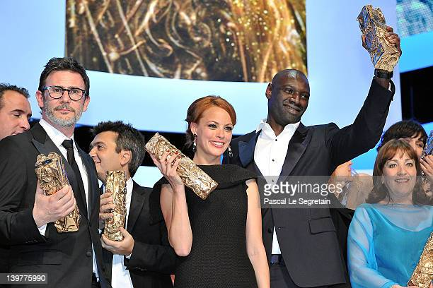 Michel Hazanavicius Thomas Langmann Berenice Bejo Omar Sy and Carmen Maura pose on stage with their Cesars during the 37th Cesar Film Awards at...