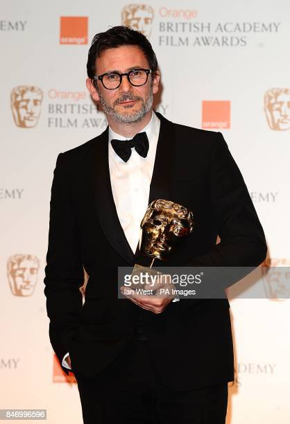 Michel Hazanavicius with the Original Screenplay award for 'The Artist' in the press room at the 2012 Orange British Academy Film Awards at the Royal...