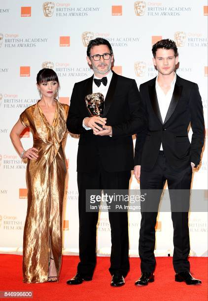 Michel Hazanavicius with the Original Screenplay award for 'The Artist' with presenters Jeremy Irvine and Christina Ricci in the press room at the...
