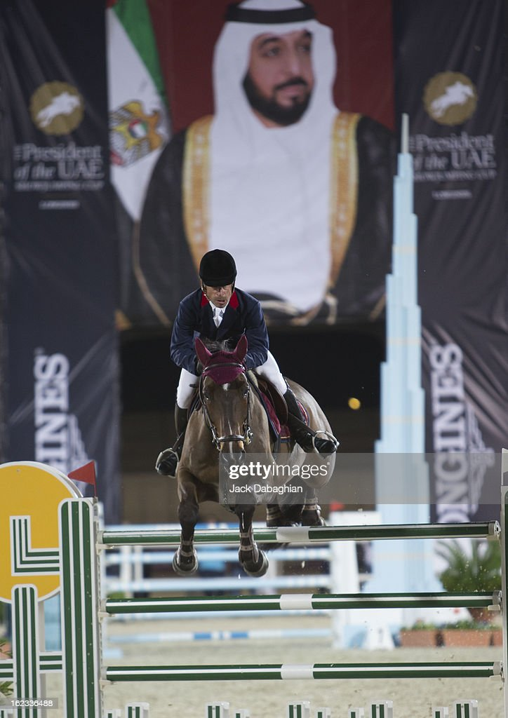 Michel Hecart of France clears a hurdle on Quatrin de La Roque during the President of the UAE Showjumping Cup - Furusyiah Nations Cup Series presented by Longines on February 21, 2013 in Al Ain, United Arab Emirates.