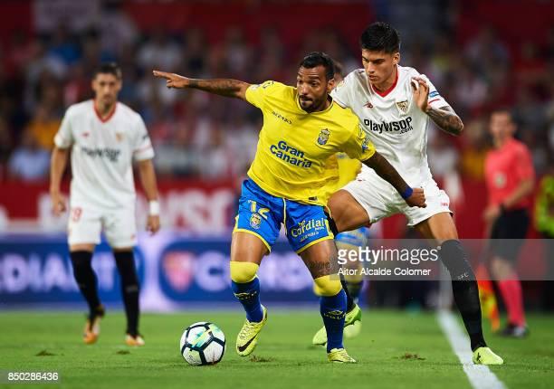 Michel Macedo of Union Deportiva Las Palmas being followed by Joaquin Correa of Sevilla FC during the La Liga match between Sevilla and Las Palmas at...