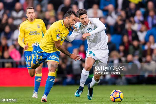 Michel Macedo Rocha Machado of UD Las Palmas fights for the ball with Marco Asensio Willemsen of Real Madrid during the La Liga 201718 match between...