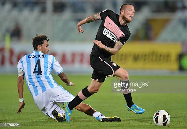 Michel Morganella of Palermo and Emmanuel Cascione of Pescara compete for the ball during the Serie A match between Pescara and US Citta di Palermo...