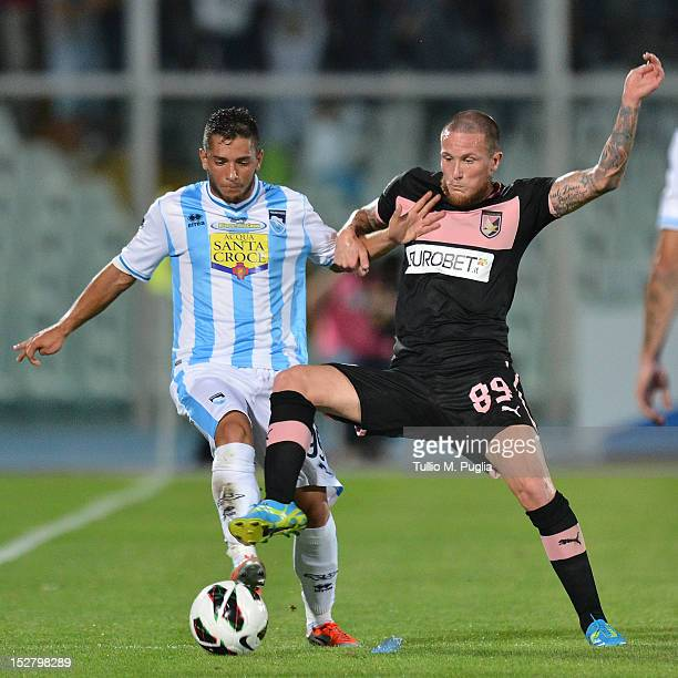 Michel Morganella of Palermo and Gianluca Caprari of Pescara battle for the ball during the Serie A match between Pescara and US Citta di Palermo at...