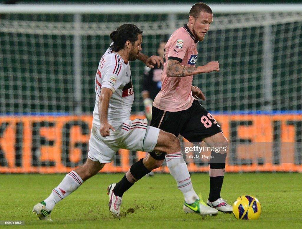 <a gi-track='captionPersonalityLinkClicked' href=/galleries/search?phrase=Michel+Morganella&family=editorial&specificpeople=2484261 ng-click='$event.stopPropagation()'>Michel Morganella</a> (R) of Palermo is challenged by <a gi-track='captionPersonalityLinkClicked' href=/galleries/search?phrase=Mario+Yepes&family=editorial&specificpeople=648682 ng-click='$event.stopPropagation()'>Mario Yepes</a> of Milan during the Serie A match between US Citta di Palermo and AC Milan at Stadio Renzo Barbera on October 30, 2012 in Palermo, Italy.
