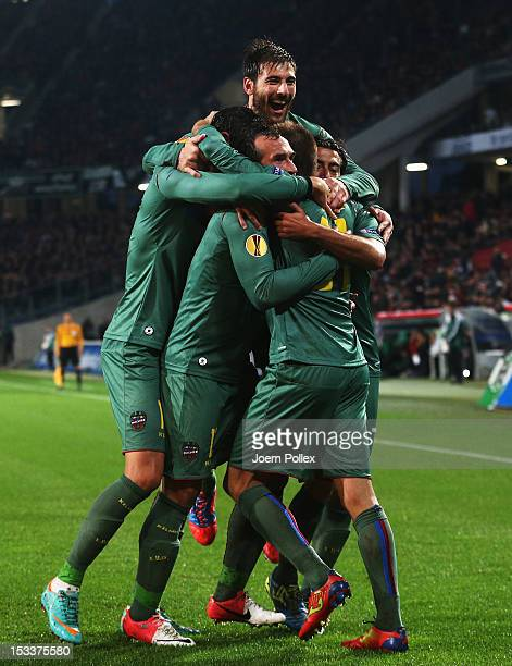 Michel of Levante celebrates with his team mates after scoring his team's first goal during the UEFA Europa League Group L match between Hannover 96...