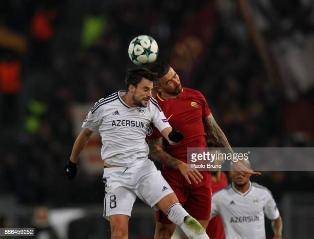 Michel of Qarabag FK competes for the ball with Aleksandar Kolarov of AS Roma during the UEFA Champions League group C match between AS Roma and...