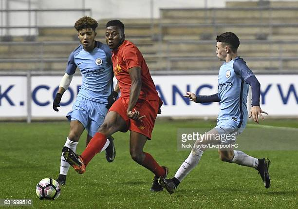 Mich'el Parker of Liverpool and Jadon Sancho and Phil Foden of Manchester City in action during the Manchester City v Liverpool FA Youth Cup game at...