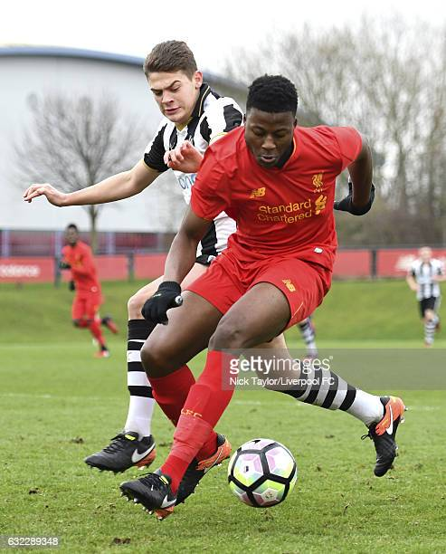 Mich'el Parker of Liverpool and Lewis McNall of Newcastle United in action during the Liverpool v Newcastle United U18 Premier League game at The...