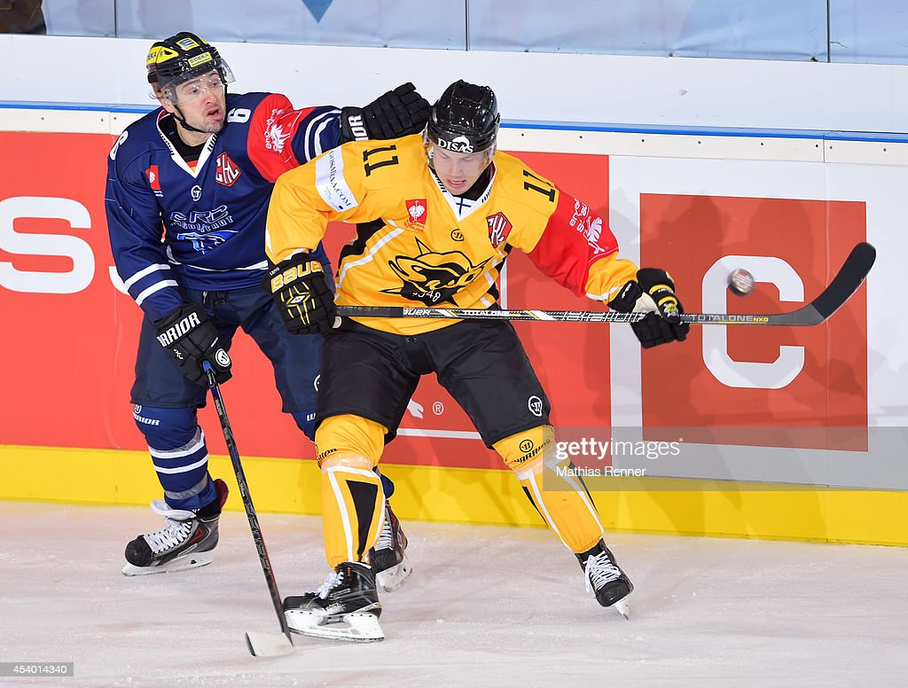 Michel Periard #6 of ERC Ingolstadt and Tomi Leivo #11SaiPa Lappeenrant fights for the puck of during the Champions Hockey League group stage game between ERC Ingolstadt v SaiPa Lappeenranta on August 23, 2014 in Ingolstadt, Germany.
