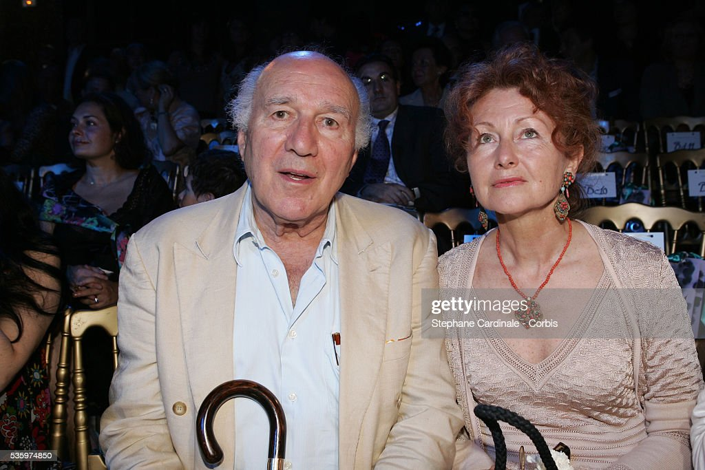 Michel Piccoli and his wife attend the Christian Lacroix 'Haute Couture' Fall/Winter 2005-2006 Fashion collection.