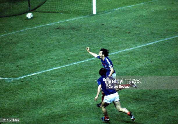 Michel Platini and Bruno Bellone of France celebrate scoring his goal during the European Championship match between France and Denmark at Parc des...