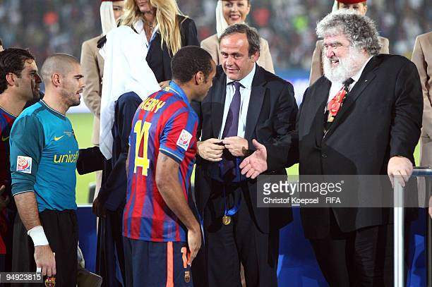 Michel Platini and Chuck Blazer watch Thierry Henry of Barcelona during the ceremony after the FIFA Club World Cup Final match between Estudiantes LP...