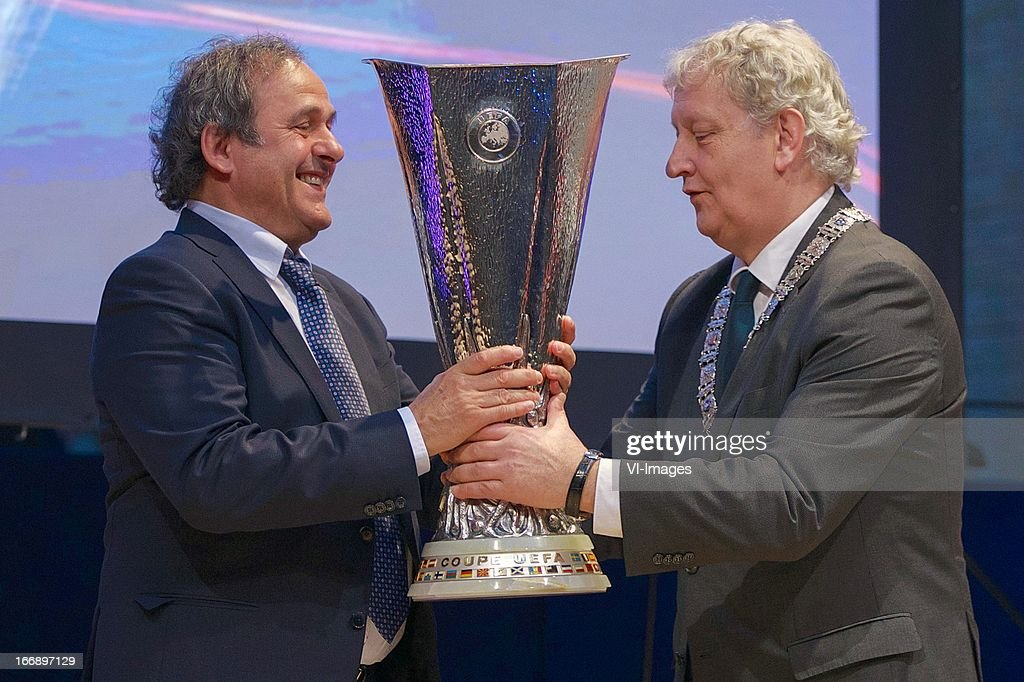 <a gi-track='captionPersonalityLinkClicked' href=/galleries/search?phrase=Michel+Platini&family=editorial&specificpeople=206862 ng-click='$event.stopPropagation()'>Michel Platini</a>, burgermeester Eberhard van der Laan during the UEFA Europa League trophy handover ceremony on April 18, 2013 at Amsterdam, The Netherlands.