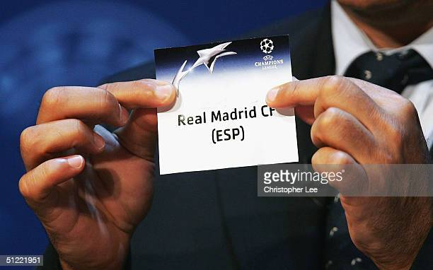Michel Platini draws out Real Madrid during the UEFA Champions League Draw for the first stage of the Season 2004/05 at the Grimaldi Forum on August...