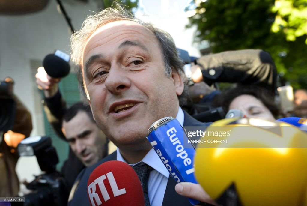 Michel Platini is surrounded by journalists as he arrives at the Court of Arbitration for Sport to appeal his six-year FIFA ban for ethics violations on April 29, 2016 in Lausanne. The Frenchman has been sanctioned over an infamous two million Swiss franc ($2 million, 1.8 million euro) payment he received in 2011 from then-FIFA president Sepp Blatter. / AFP / FABRICE