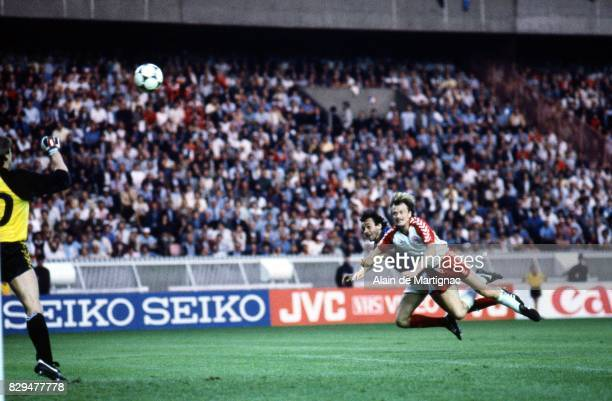 Michel Platini of France and Soren Busk of Denmark during the European Championship match between France and Denmark at Parc des Princes Paris France...