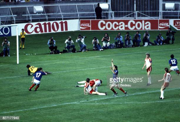 Michel Platini of France celebrates scoring his goal during the European Championship match between France and Denmark at Parc des Princes Paris...