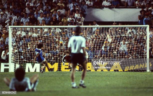 Michel Platini of France score a penalty Harald Schumacher of Germany during of the game Semi Final World Cup match between West Germany and France...