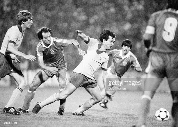 Michel Platini of Juventus is held by Jaime Pacheco of FC Porto during the European Cup Winners Cup Final held at St JakobPark in Basle Switzerland...