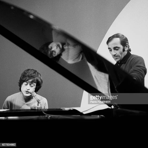 Michel Polnareff and Charles Aznavour rehearse in the studio at the Olympia music hall