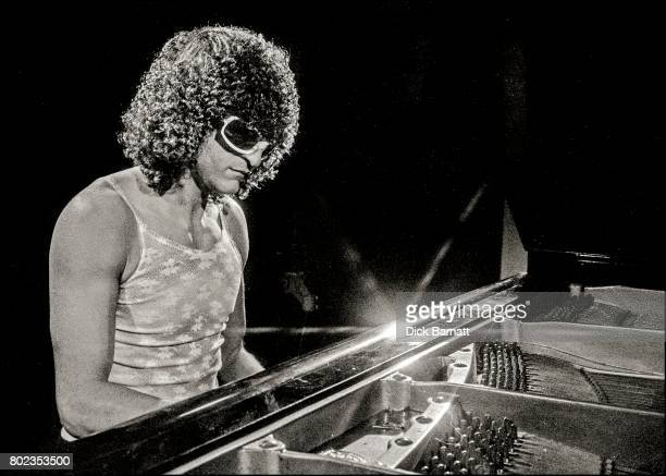 Michel Polnareff playing piano in a recording studio London 1976