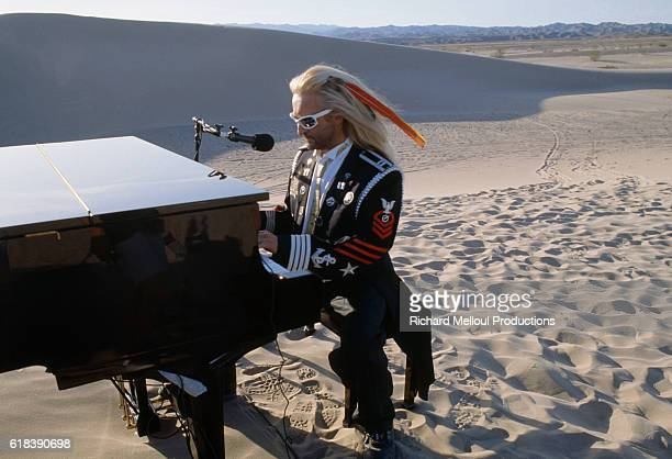 Michel Polnareff plays piano during a Canal interview to promote his new release after a five year break